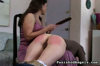 Krissy0  first with her jeans on then with them removed and her anus bare a young brunette gets her anus spank  she is over the knee of a woman older than she is who is seated on a chair and the young brunette does not complain or protest but after the ot. First with her jeans on, then with them removed and her butthole bare, a young brunette gets her butthole spanked. She is over the knee of a woman older than she is, who is seated on a chair, and the young brunette does not complain or protest, but after the other